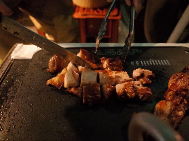 Rasta cutting chicken