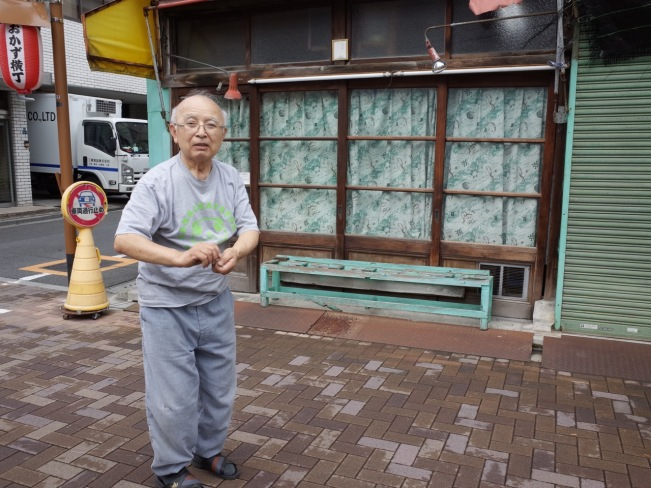 okazu-tasaki-striking-a-match